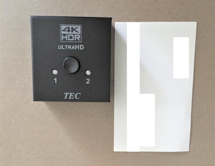 HDMIセレクターTHDSW2W-4K60と名刺を比べた写真